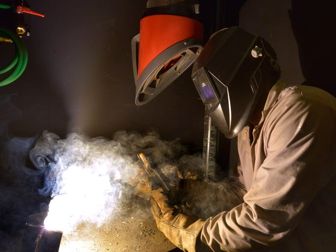 Student Robert Jones puts his classroom and simulation training into practice during a live welding exercise at the Pensacola State College Century campus Tuesday morning July 15, 2015.