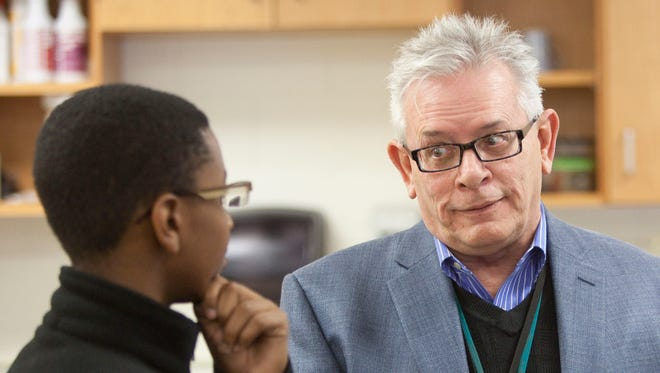 Robert Guffin, who had been named executive director of the State Board of Education in May 2014, announced that he will retire at the end of this month. Guffin, formerly the principal at Harshman Middle School in Indianapolis, is shown counseling a student at the school.