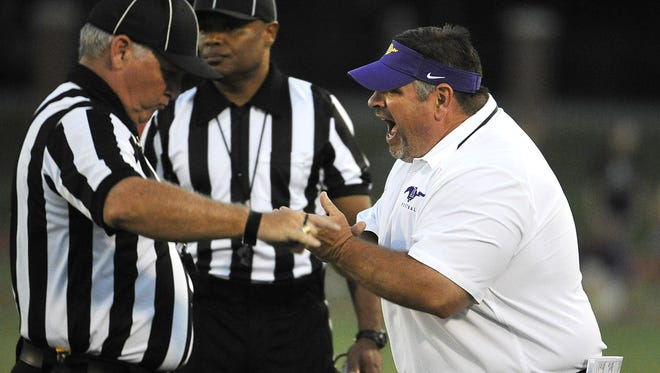 Scott Tillman, right, compiled a 35-32 record in his five-plus seasons as the Lipscomb Academy football coach.
