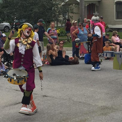 Clowns entertain the crowd Saturday in Bristol during