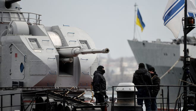 Soldiers guard a Ukrainian navy ship.