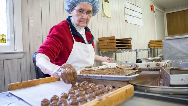Nancy Lacy, a worker at Lowery's Candies creates peanut butter creams Jan. 31 at the chocolate shop. The long standing local business is one of 15 vendors bringing chocolates for a fundraiser for Second Harvest Food Bank at their facility on Friday.