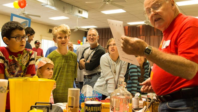 Retired Virginia Military Institute physics professor Rae Carpenter holds children spellbound with his array of science-oriented demonstrations at last year's Lexington Science Festival & Maker Faire.