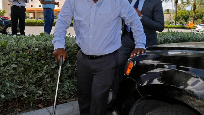 Healthcare professional Charles Kinsey, shot by a North Miami police officer on July 18 while trying to protect an autistic patient, makes his first public appearance in Aventura, Fla., Thursday, July 28, 2016. Kinsey, an unarmed black therapist who was shot in the leg by police last week while protecting his severely autistic client, said he had a joyful reunion Thursday with the man who remains hospitalized because of emotional trauma. (Carl Juste/Miami Herald via AP)