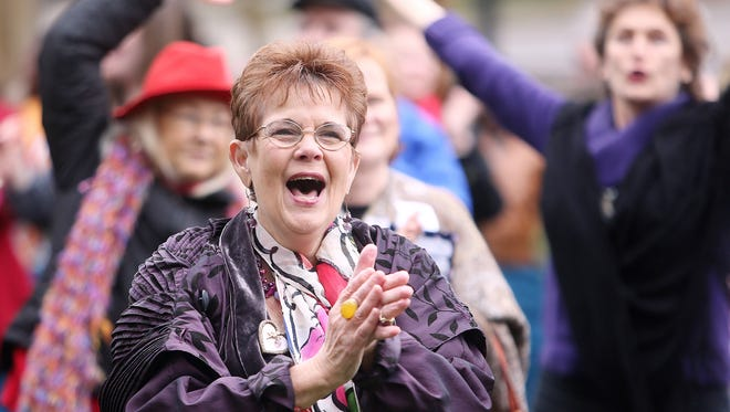 Barbara DeVane gives her approval during a rally to protest violence against women.