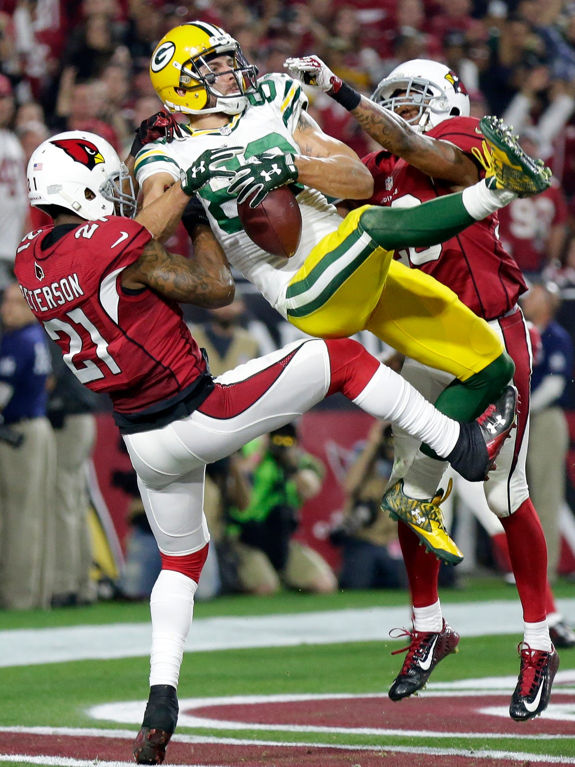 Green Bay Packers receiver Jeff Janis catches a touchdown pass from Aaron Rodgers at the end of regulation tying the game and forcing overtime.