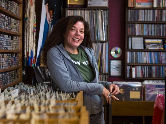 Groovacious owner Lisa Cretsinger poses for a photo in her Cedar City record store Thursday.