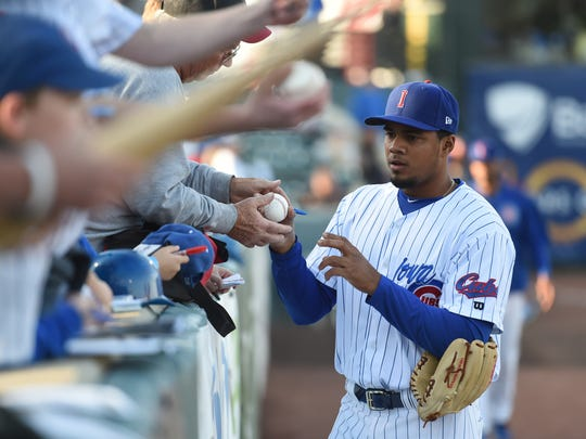 Iowa Cubs' Jeimer Candelario (35) stops to sign autographs on Tuesday, April 11, 2017, during the home opener baseball game between the Iowa Cubs and the New Orleans Baby Cakes at Principal Park.