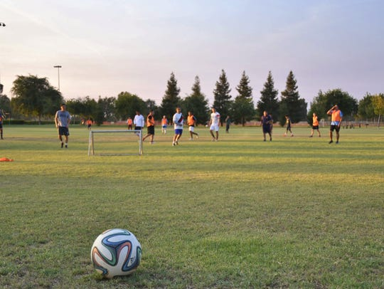 A group of soccer players practices at Visalia's Riverway