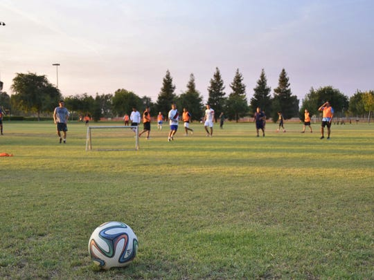 A group of soccer players practices at Visalia's Riverway Sports Park on Tuesday, July 17. Smoke from nearby wildfires has caused concern for air quality officials.
