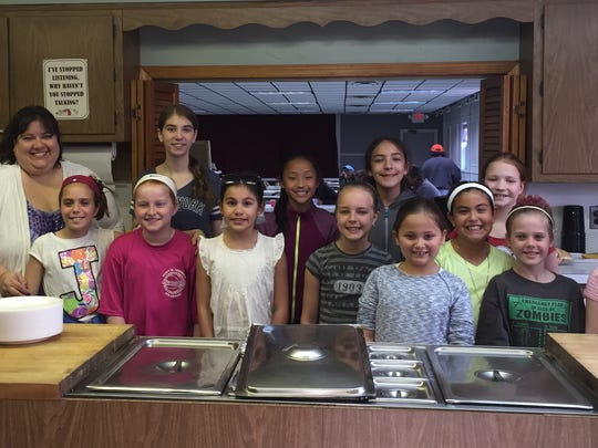 Members of the Woodland Service Club prepared and served meals at the South Bound Brook soup kitchen on April 20.