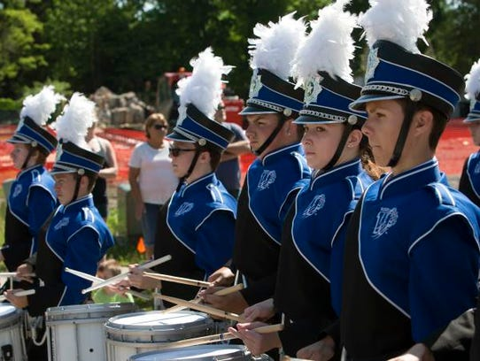 Oshkosh West High School band marches in the Memorial