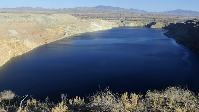 """Vivid colors in """"The Pit"""" at Anaconda Copper Mine is a reminder of the chemicals that leach into the area's water."""