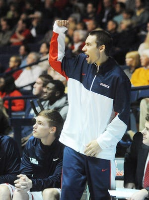 Mississippi's Marshall Henderson, standing, cheers on his teammates.
