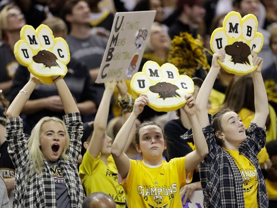 UMBC fans cheer their team, which made history Friday
