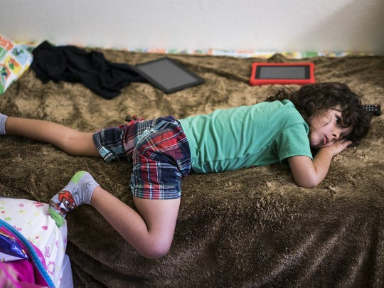 Syrian refugee Joud Almkhlef, 7,who resettled in Arizona