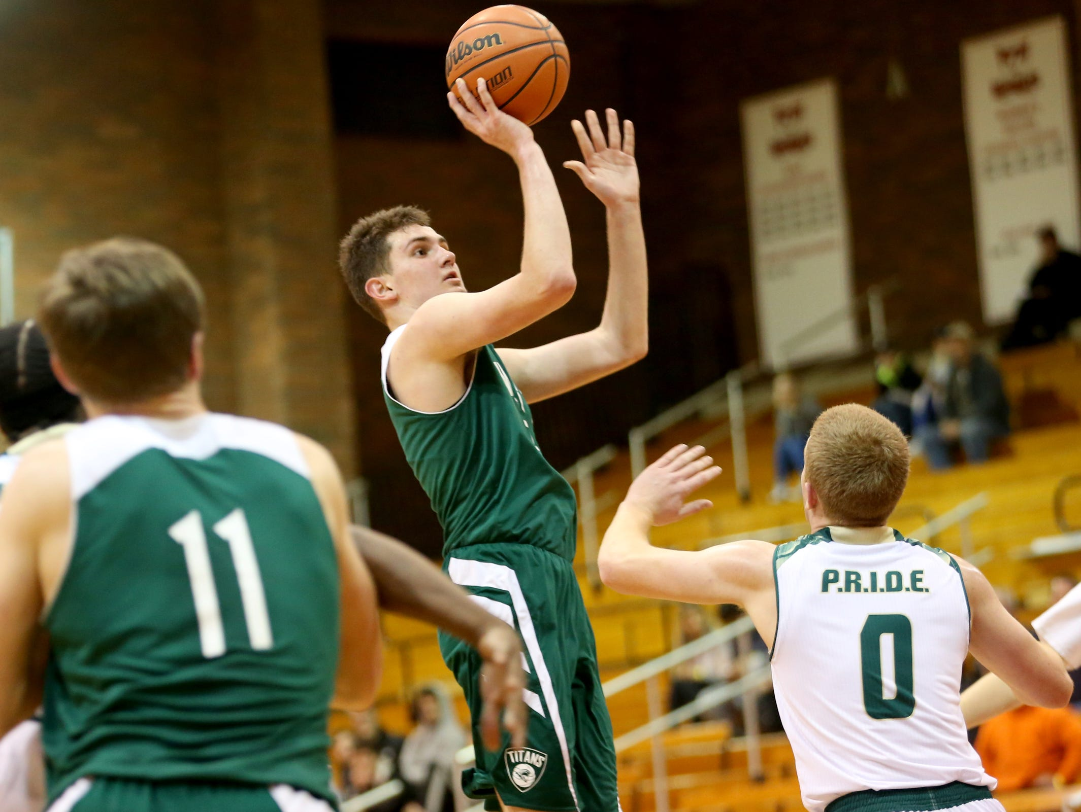 West Salem's Kyle Greeley (5) shoots in the West Salem vs. Evergreen boy's basketball game on the first day of the Capitol City Classic tournament at Willamette University in Salem on Wednesday, Dec. 21, 2016. West Salem won the game 72-52.