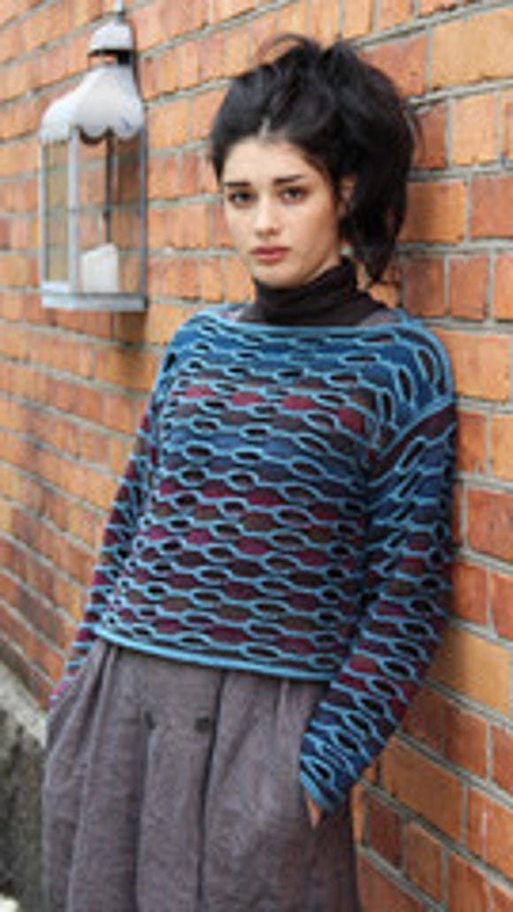 "In another design from Cornelia, ""Dulcinea,"" you can see the lighter weight yarn embossing the body and sleeves of this lovely sweater."