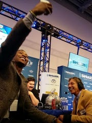 New York Giants wide receiver Brandon Marshall takes a selfie with Jets Hall of Fame quarterback Joe Namath on Super Bowl Radio Row in San Francisco.