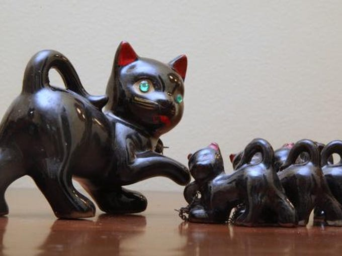 Stylemaker Merrill Simmons has black cat mother and kitten figurines.  She has a weakness for all things black cat.  This is from her black cat collectionl Photo by Michael Hayman