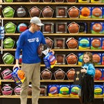Rod Call and his daughter Savannah Call, 5, pick out basketballs while shopping on April 1, 2016 in Traverse City, Mich, for basketball gear for children in his Milk Crate Basketball project, which helps disadvantaged youth with obtaining equipment to play the game.