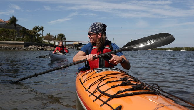 Well known German travel journalist, Dr. Dirk Rohrbach pulls up at the Mound House on Fort Myers Beach on Thursday as he starts his nine day adventure paddling the Calusa Blueway. He is traveling with Claudia Axmann who is documenting him on his trip.