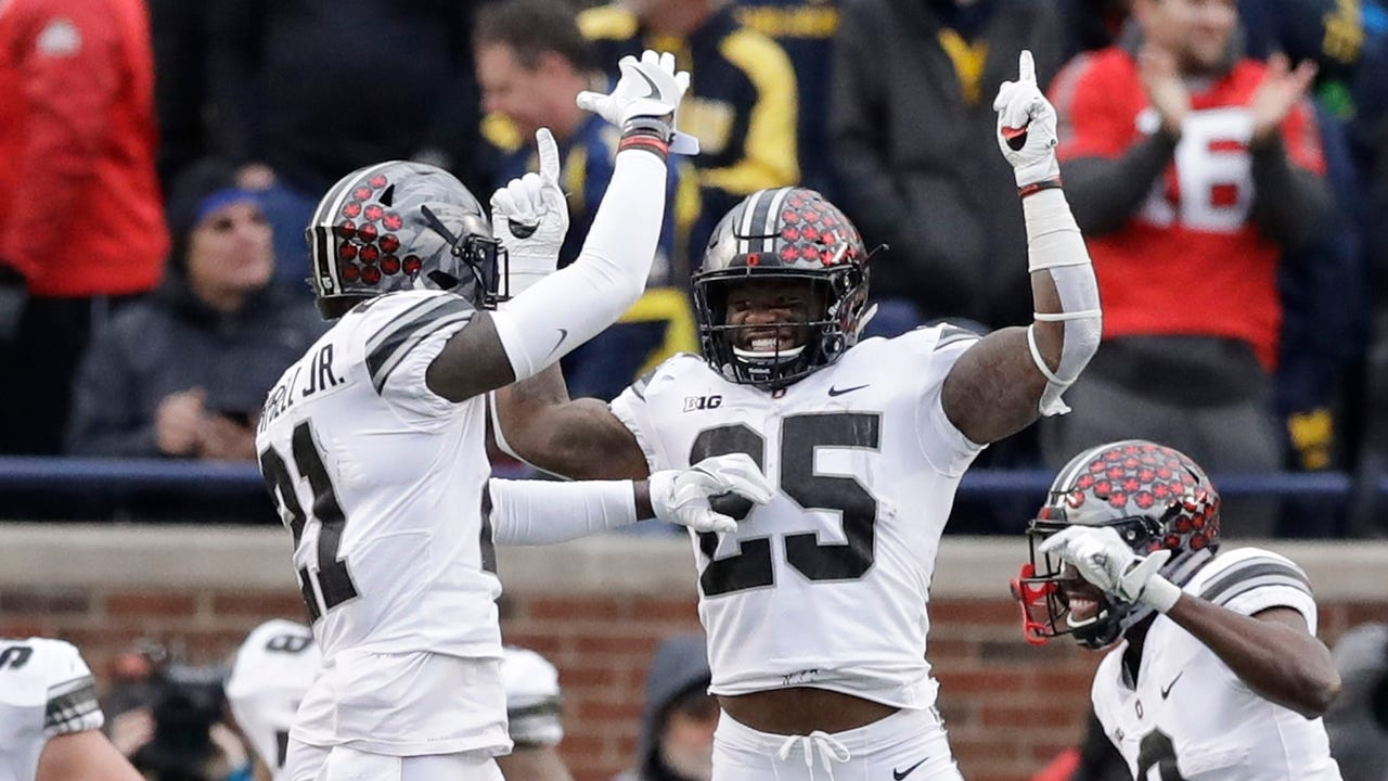 Ohio State overcame an early 14-point deficit and an injury to quarterback J.T. Barrett to beat Michigan for the sixth straight year.