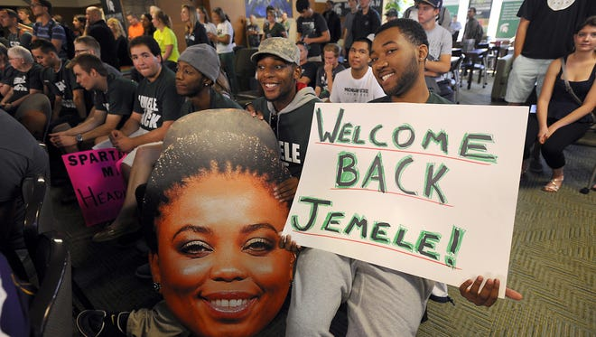 """People gather as Michigan State graduate and ESPN broadcaster Jemele Hill hosts """"Numbers Never Lie"""" on ESPN2 from East Lansing on Sept. 26, 2014."""