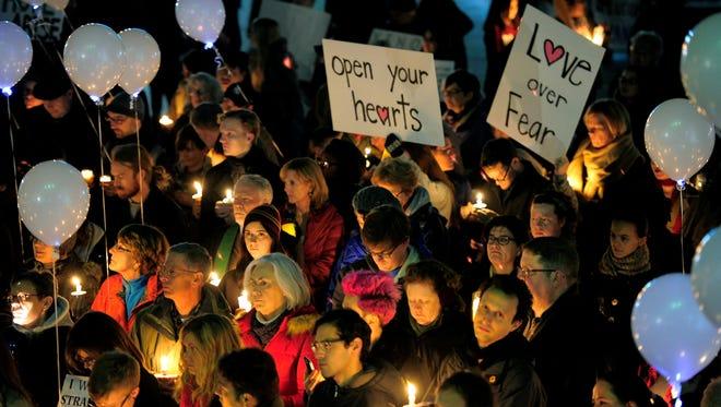 Supporters of Syrian refugee programs participate in a candlelight vigil Monday, Nov. 23, 2015, on Legislative Plaza in Nashville.