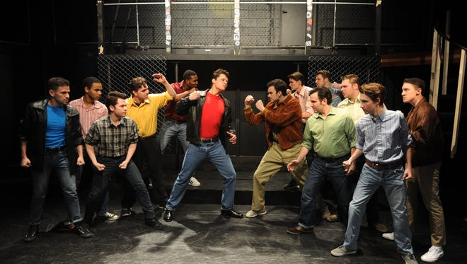 "The Sharks (left) and the Jets (right) face off in ""West Side Story""."