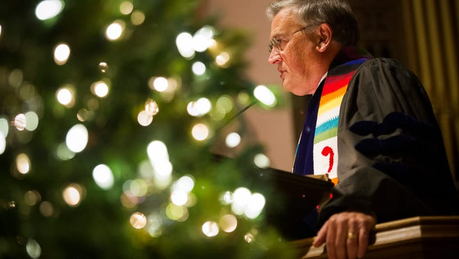 Rev. Lynn Martin, pastor of St. Lucas United Church of Christ, delivers a sermon during an interfaith service for World Aids Day at St. Lucas United Church of Christ in Evansville, Thursday, Dec. 1. 2016. World AIDS Day started in 1988 and falls on Dec. 1, annually.