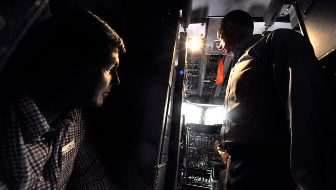 U.S. Rep. Jodey Arrington (left) of District 19 and U.S. Representative Mac Thornberry of District 13 listen to a pilot's explanation of the B1 bomber inside the cockpit Thursday August 3, 2017. Both congressmen toured Dyess Air Force Base Thursday, Thornberry is chairman of the House Armed Services Committee. Arrington was sitting in the backseat so his 6-year-old son, Nathan, could sit in the pilot's seat.