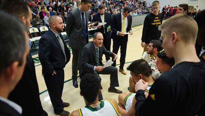 Vermont coach John Becker talks to the team during a timeout earlier this season at Patrick Gym.