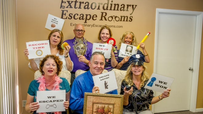 "After some ""escape"" guests have successfully solved all of their clues, they celebrate victory!"