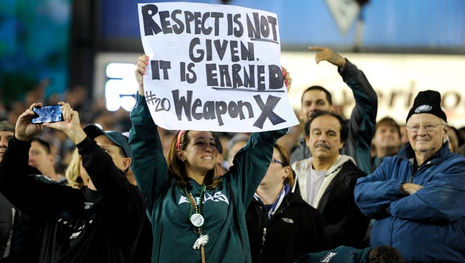 A spectator holds up a sign during a halftime celebration for Brian Dawkins jersey retirement in 2012 at Lincoln Financial Field. Dawkins' connection with Eagles' fans always remained prevalent over his time with the franchise.