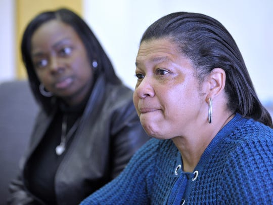 Virginia Burroughs, right, 52, of Detroit, talks about