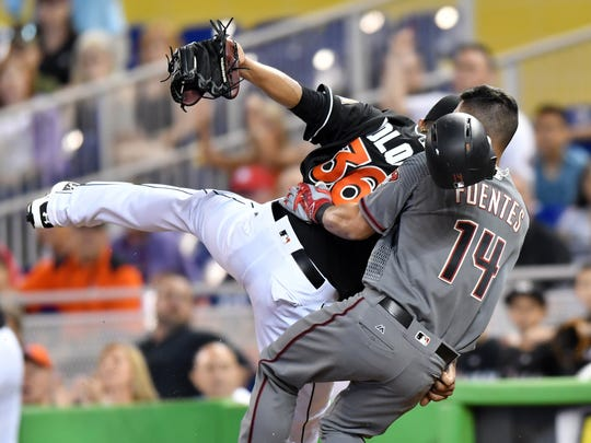 The Arizona Diamondbacks' Reymond Fuentes  collides
