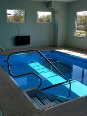 The natatorium contains a warm water therapy pool,
