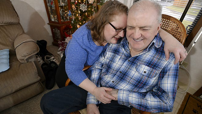Phil Hamilton, who is blind, and his wife Beverly,  at home in Haslett Wednesday 12/24/2014.  Phil is battling a wide variety of health problems as a result of swine flu and is saddled with a large amount of medical debt.