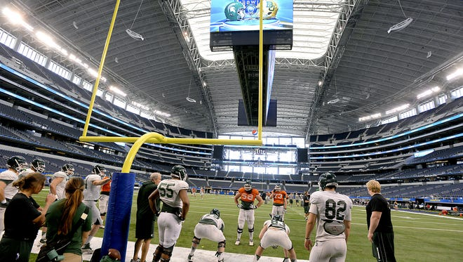 Michigan State practices earlier this week at AT&T Stadium in preparation for today's Cotton Bowl against Baylor.