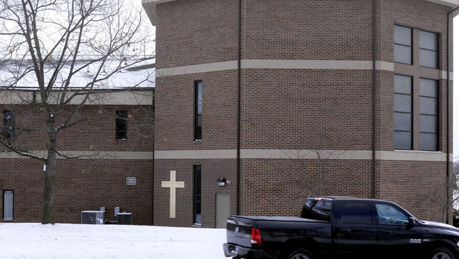 Traffic on southbound MLK Jr.  Blvd. moves past Union Missionary Baptist Church in Lansing Tuesday Jan. The cross on the building marks the spot of a previous fatal accident when a driver hit the building.