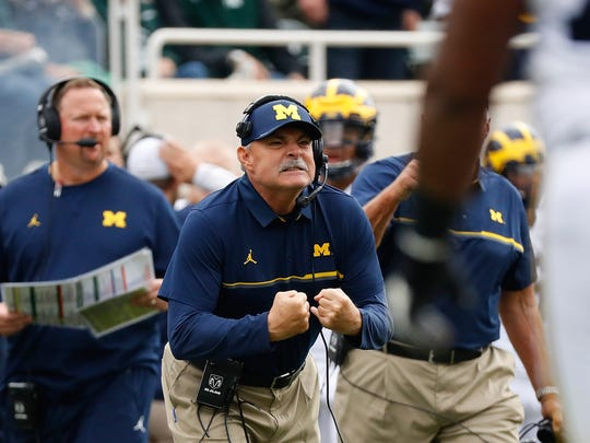 Michigan defensive coordinator Don Brown works against Michigan State on Oct. 29, 2016, in East Lansing.
