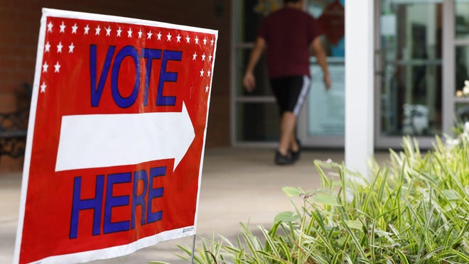 A voter enters a polling place at Gaines Elementary School in Athens in June.