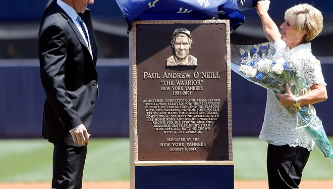 Former Yankee Paul O'Neill and his wife, Nevalee, unveil a plaque that will be displayed in Yankee Stadium's Monument Park as O'Neill is honored in a pregame ceremony before Saturday's Yankees-Indians game.