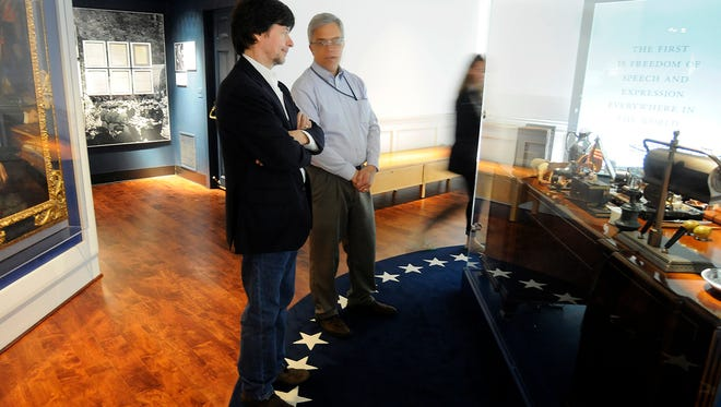 Documentary filmmaker Ken Burns, left, tours the FDR Library and Museum in Hyde Park on Thursday. To his right is Herman B. Eberhardt, supervisory museum curator.