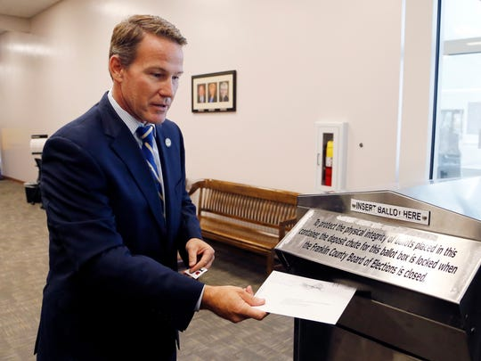 Ohio Secretary of State Jon Husted, a Republican, is running for governor. In this file photo, Husted drops off his early voting ballot ahead of the November 2016 election. (AP Photo/Jay LaPrete, File)