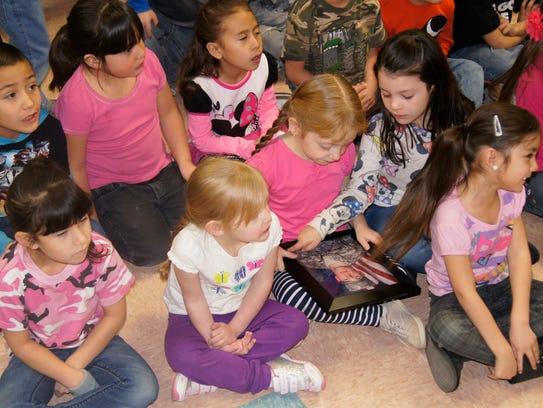 Kindergarten student Carylon Zollinger, 5, holds a