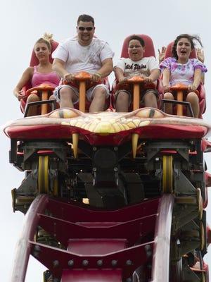 Parkgoers ride the Diamondback rollercoaster at Kings Island in 2011.