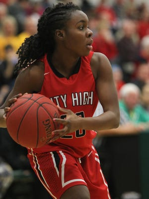 City High's Rose Gamamou looks for an open teammate during the Little Hawks' game at West High on Friday, Jan. 8, 2016.