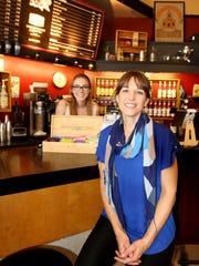 Silver Falls Coffee House owner-operator Elisha Nightingale (right) and barista Emily Payley on Wednesday, May 18, 2016.
